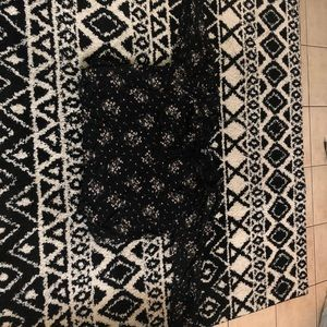 Long sleeve black blouse with flowers on it